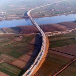 Aerial view - View of the Padana plain and the motorway bridge on the Po river